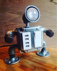 """This handmade """"industrial robot"""" lamp design with 4 functioning USB outlets is…"""