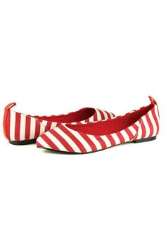 Flats made of fabric and rubber, featuring all over stripes, almond toe, low cut vamp with slip on style.