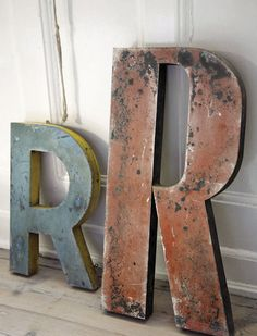 Old Sinage letters, great way to bring a rustic but colorful texture to a room.