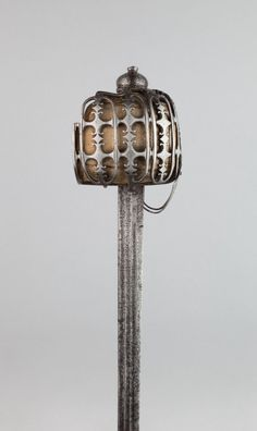 Scottish  Basket-Hilted Broadsword (Claymore), c. 1760  Steel, wood and leather Overall L. 101.5 cm (39 15/16 in.) Blade L. 88.3 cm (34 3/4 in.) Wt. 2 lb. 13 oz.
