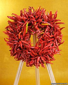 Chili peppers can do more than flavor your foods; they can also decorate a door. Martha Stewart shows you how to make them into a long-lasting chili pepper wreath that celebrates the harvest season and keeps these spicy delights at hand for cooking.