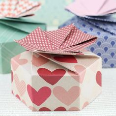 {Video Tutorial} on how to make these adorable petal boxes with just a scoring board! Great for Valentine treats and small gifts!