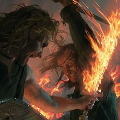 The Hound takes on Beric Dondarrion and his flaming sword    By Michael Komarck for the 2009 A Song of Ice & Fire Calendar