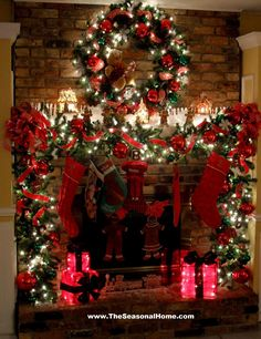the fullness of the beribboned garland with lights and the wreath ... use this as inspiration for the fireplace in the living room.
