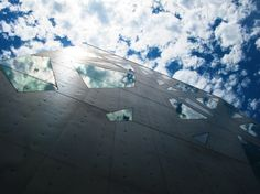 """Tokyo. """"As I stopped for a moment while window-shopping in the Omotesando district, I looked up: Above me, the clouds and cool blue sky were seemingly being drawn down toward the ground, crisply reflected in the ice shard–shaped windows of the Tod's building."""" - Kathryn Maier, Senior Assistant Editor"""