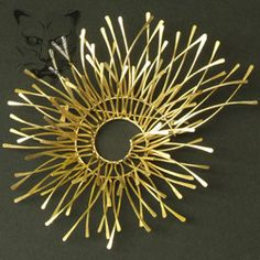 Kayo Saito: Large wire structured brooch, inspired by creatures from the sea. Materials used: 18ct Gold