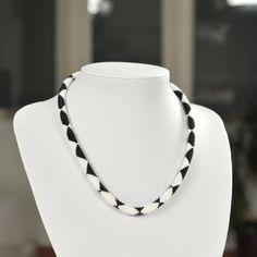 Unique handmade black & white bead necklace made of black and white beads and white thread.