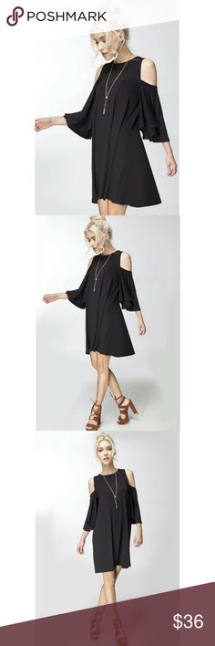 Cold Shoulder Swing Dress Chic and flirty swing dress features a cold shoulder sleeve, beautiful ruffle sleeves and adorable swing fit.  Color - Black Solo La Fe Dresses Mini