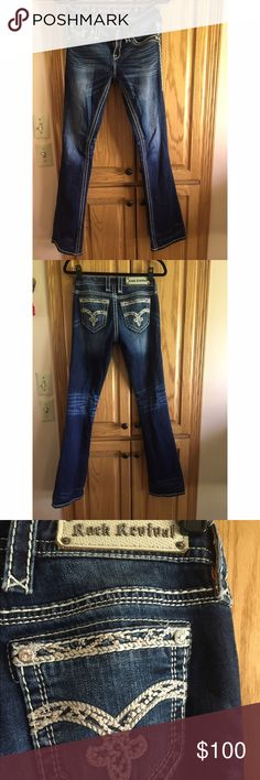 Dazzled Rock Revival jeans A pair of mid wash Rock Revival jeans that are perfect for a night out. These jeans are stitched on the pockets and the sides of legs with flashy white and gold thread, and are dazzled with silver rhinestones. They are finished with a silver gem button. Rock Revival Jeans Boot Cut