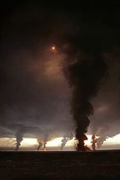 "This is the Kuwait oil fields burned by the retreating Iraqi forces near the end of the 1991 Persian Gulf War.This is often labelled as ""multiple tornadoes"" but is in fact a photo of the burning oil wells. One of the worst environmental disasters ever."