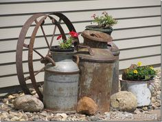 Sitting Pretty Love the rusty milk cans and the wheel. Might could use this idea on the porch or back patio. Pretty Love the rusty milk cans and the wheel. Might could use this idea on the porch or back patio.Love the rusty milk cans and the wheel. Garden Junk, Garden Yard Ideas, Lawn And Garden, Garden Projects, Milk Can Garden Ideas, Garden Planters, Garden Beds, Mailbox Garden, Garden Benches