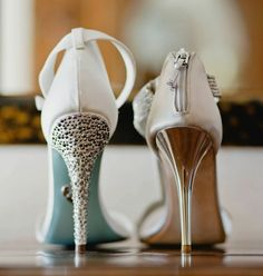 Side-by-side shot of the brides' shoes | Luna Gardens Events