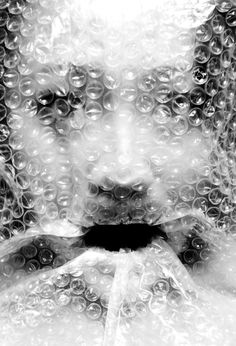 I love that this picture exists.  The bubble wrap over the woman's face not only makes this picture very eerie and horror-esque, but the black and white filter adds to the effect really well.