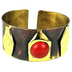 Red Jasper Brass Cuff Handmade and Fair Trade. South African artisans alternate colors of brass in this handmade brass cuff that is accented with a red jasper stone. The coloration is achieved by applying high heat rather than paints or dyes.Bracelet dimensions: 32 mm wide x 7 inches long.