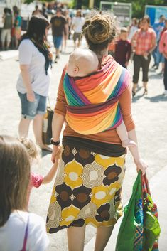 {Love everything about this image! her dread up-do, the colors and the baby on Mama's back!}