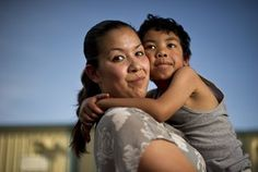 """Crystal Nguyen, a former inmate at Valley State Prison seen with son Neiko Nguyen, said she worked in the prison infirmary. She said she often heard the medical staff ask repeat offenders to agree to be sterilized. """"I was like, 'Oh my God, that's not right,' """" Nguyen recalls. / Noah Berger For the Center for Investigative Reporting"""