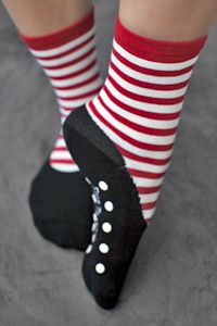 Slipper socks with faux flats and red & white stripes, for a cute doll look with terry lining that will keep your toes cozy and non-skid bottoms that will keep you a little more secure when playing house.