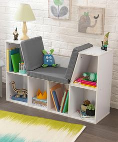 This bookcase features a built-in reading nook, complete with a comfy cushion, for a little bookworm to settle in among their favorite literature and embark on fantastic journeys of the mind.