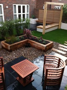 This contemporary garden design features black limestone paving, a chunky oak frame which will support a great new shade sail.