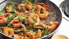 Add something colorful to your family's Asian cuisine night! Serve stir fried shrimp and vegetables with quinoa - a hearty meal.