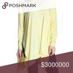 Yellow Ribbed Dolman Tunic Yellow V-neck long sleeve tunic with ribbed look. 95% Rayon,  5% Spandex. Tops Tunics