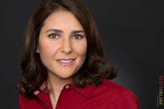 Colleen Wilson in a red shirt in this headshot.