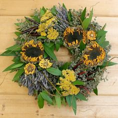 Dried sunflowers are the star on this herbal wreath with yarrow, bay, lavender, and chili de arbol. Shop for summer wreaths at Creekside Farms!