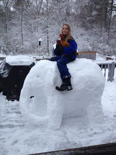 Elephant snow sculpture by Dawn Gould with her daughter and two chickens!