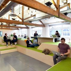 An indoor village green, bleacher-style seating and a reception desk modelled on…
