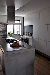Concrete, metal and plywood kitchen
