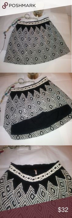 Free People Skirt Beautiful black and white skirt from Free People. Size 6 waist measures 28 inches. Free People Skirts Mini