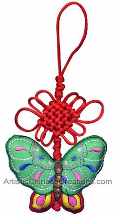 """Chinese Arts Crafts / Chinese Gifts / Chinese Folk Art: Chinese Knots - Embroidered Butterfly by Artistic Chinese Creations. $18.00. 100% Hand made Chinese knots.. Chinese Knots - Embroidered Butterfly. Suggested Uses: Auto Mirror Hanging, Lamp Hanging or Door Hanging. Group Hangings can also be very attractive.. Brightly colored fabrics hand-stitched to create fanciful embroidered butterfly.. Size: 7"""" x 5"""" (18cm x 12.5cm). Chinese Knots - Embroidered Butterfly: Bri..."""