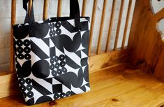 Look stylish and be gentle on the environment with this bold geometric reusable tote. The pattern is made with forms from my font; FormPattern. The pattern covers the whole surface of the bag  It can hold about five 250 page hardcover books and still have room for a pencil case.