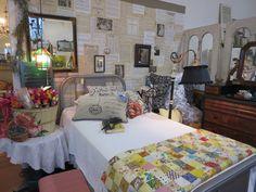 Antique metal bed, Vintage quilt, sheet music walls  https://www.facebook.com/LaBelleBrocanteShop/
