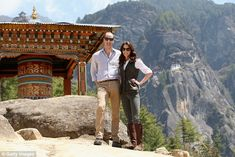 Kate and William pose next to a prayer wheel on the trek up to Tiger's Nest during a visit to Bhutan in April 2016