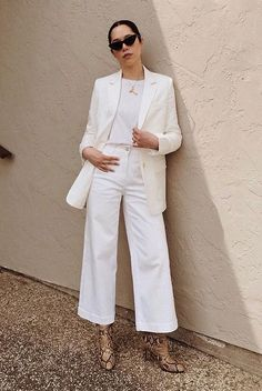 @craftandcouture wearing a white blazer, a white t-shirt, white crop wide leg jeans, snakeskin boots and black cat eye sunglasses. Workwear, workwear women, spring work outfits, spring work outfits 2019, officewear, business casual, wear to work, work styles, spring outfits, spring style, #weartokork #officewear #businesscasual #workwear #workoutfits #9to5chic #springstyle #springfashion2019 #fashion2019 #ootd #streetstyle