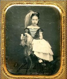 ca. 1850's, [portrait of a young girl on a rocking horse]  What a beautiful photo!