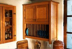 Craftsman style cabinets with rack for plates.