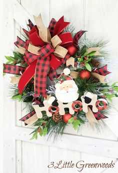 "🌲 This Santa Christmas Wreath with Buffalo Plaid Bow is bursting with a variety of evergreens . Everything is tucked around an adorable ""HoHoHo"" Santa Sign. The finishing touch is the large buffalo plaid bow that adds so much country Christmas charm. Outdoor Christmas Wreaths, Outside Christmas Decorations, Diy Christmas Garland, Christmas Wreaths For Front Door, Santa Christmas, Country Christmas, Simple Christmas, Outdoor Decorations, Christmas Ideas"