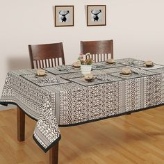 Buy charming black designer dining room table covers online in India from saavra.com & dine in the luxury of indo-western theme table covers.