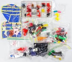 Lot 629: Mattel Barbie Doll Family Accessory Assortment; Including shoes, boots, a dog bed, 1990s Barbie comic books, hangers, purses, cards and accessories for Barbie, Barbie size and other vintage dolls