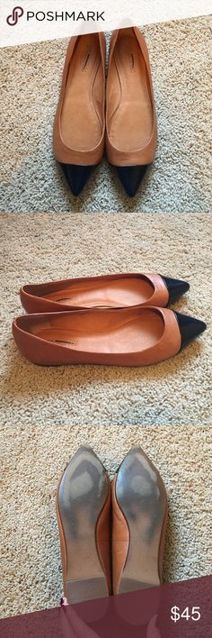 Madewell Cap Toe Skimmer Flat, Size 9.5 Awesome Madewell flats. Cognac leather with a black pointy toe cap. Size 9.5 and fit true to size. Worn just a couple times and in awesome condition. A couple small cuffs on heels (picture) and normal wear on soles, but otherwise in perfect condition. Logo marked to prevent store return. Hoping to find these a good home! I love them and hoped I'd be able to make them work, but they're a half size too big for me. Madewell Shoes Flats & Loafers