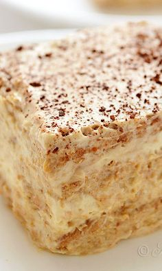 Cappuccino Icebox Cake // 3 Tbsp instant cappuccino mix + 2 Tbsp water (or milk) 2 cups whipping cream 2 cups Greek yogurt 2 tsp vanilla extract 4 Tbsp brown sugar about 300 g (10.5 oz) graham crackers 5 Tbsp instant cappuccino mix + ¼ cup warm milk (for soaking crackers)