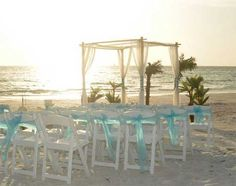 Suncoast Weddings oasis themed setting with soft drapes and blue sashes .... a Florida beach wedding dream