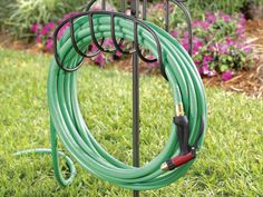 Easy to transport around a garden, this wrought iron  stand  adds visual interest to any yard. It holds up to 100' of hose.