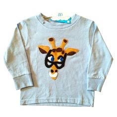 """This handmade & hand-stitched hipster giraffe will put a smile on everyone's face! A must have in the wardrobe of your little one...This would also make a memorable gift for a baby boy or baby girl!   What sets this apart is that it's made out of 100% organic cotton. Perfect for stay at home or """"out-'n-about"""" activities. Order now, only a few left!  100% Organic Cotton, Low Impact Dyes, Designed in the US"""