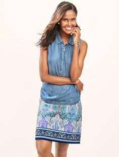 This skirt is shown with sleeveless denim popover.  They also show it with navy shell.  Print A-Line Skirt - Mykonos Paisley - Talbots