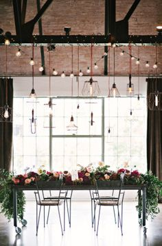 industrial wedding reception ideas with flowers and edison bulbs
