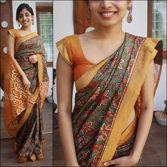 Green saree with floral print. Borders - Mustard semi brocade. Pallu - Orange and gold kota  Blouse - orange silk cotton (as in picture)