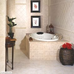 Floor features Puebla 13 x 13 in color Travertino Beige. Wall features the Puebla series in sizes 6 x 6 and 13 x 13 Mosaic Bricklay Pattern in color Beige. The wall is accented with the Puebla Torello V-Cap in color Travertino Beige. Tub features the 13 x 13 Mosaic Bricklay pattern in color Travertino Beige from the Puebla series.